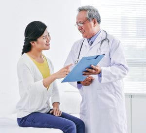 portrait of a male doctor and female patient