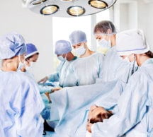 doctors and nurses during surgery